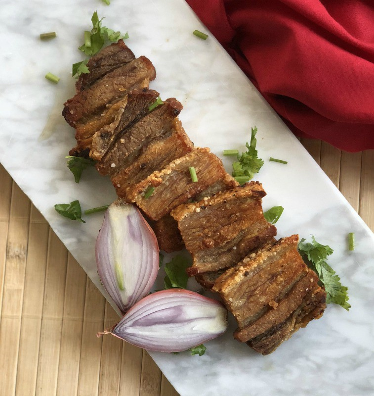 This crispy pork belly is oven baked and then pan seared in ghee to make a delicious protein to go with salad or dipped in your favorite sauce.#whole30 #paleo #keto #lowcarb