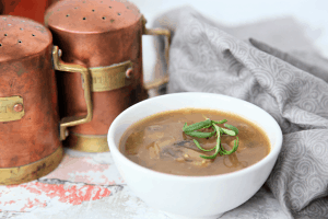 This easy mushroom gravy is brothy, thick and made with clean ingredients perfect for any holiday dish or your favorite comfort foods. #vegan #dairyfree #whole30