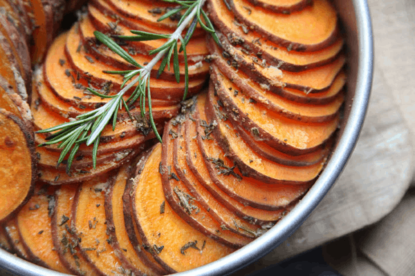 These crispy roasted sweet potatoes are sliced thin and made in the oven. A healthy oven baked side dish that looks fancy and has very few ingredients. #paleo #whole30 #sidedish #healthy #sweetpotato