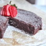 This flourless chocolate cake has simple ingredients and is easy to put together. Naturally gluten free, this cake is dense, fudgy and a hit for parties. #glutenfree #dessert #cake
