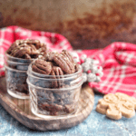 These spiced candied pecans are a perfect way to snack through the holidays. These pecans can be packaged up in mason jars to make a perfect gift for friends and family.  #paleo #glutenfree #dairyfree