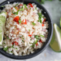 This mexican cauliflower rice uses simple ingredients and is cooked in a skillet for an easy side dish. Cauliflower rice is a great low carb, keto or whole30 alternative to white or brown rice. #whole30 #paleo #keto #lowcarb #sidedish #rice