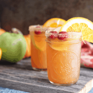 This thanksgiving punch recipe has all the flavors of fall and can be made as a cocktail or mocktail. #holiday #thanksgiving #mocktail #cocktail