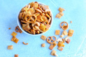 This buffalo party mix is gluten free and made with corn cereal, rice cereal, cashews and gluten free pretzels. Perfect for game day parties.