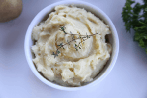 These creamy horseradish mashed potatoes add a great kick to a classic side dish using prepared horseradish. This recipe can be made on the stovetop or in your instant pot. #whole30 #paleo #sidedish