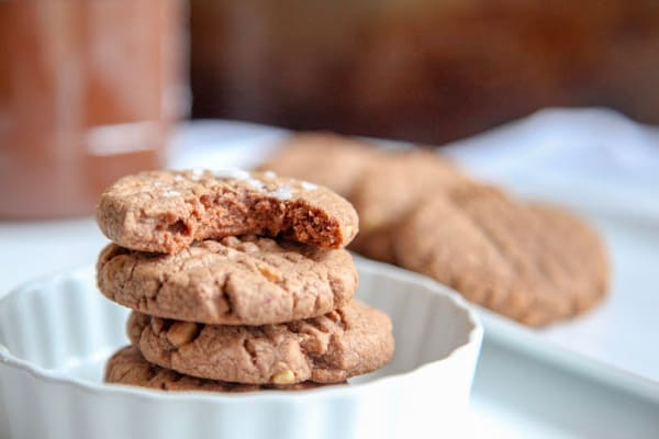 These peanut butter nutella cookies are soft on the inside with a slight crunch on the outside. They are made with only 5 ingredients including peanut butter, nutella, sugar, eggs and flour. Can easily be made gluten free.