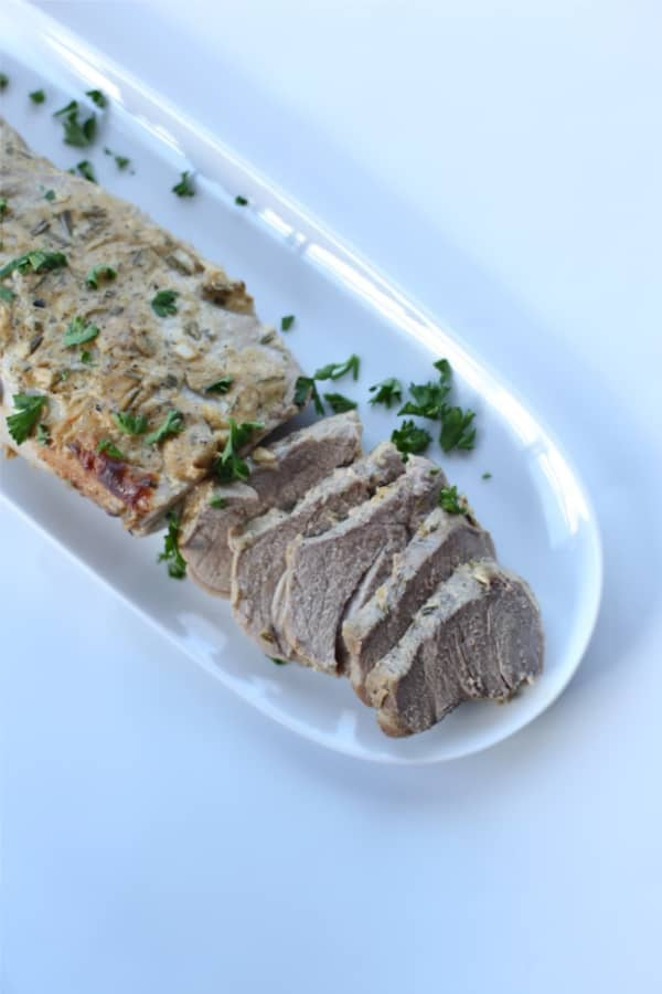 This rosemary mustard pork tenderloin is marinated with rosemary, dijon mustard, and baked in the oven for a pork tenderloin recipe that everyone will love. Rosemary pork tenderloin is suitable for the whole30, paleo and keto diet.