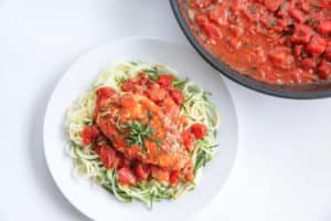 This tomato basil chicken makes a perfect easy pan marinara sauce that anyone can accomplish.  Using canned crushed tomatoes, basil, garlic, onion it is low carb, paleo, gluten free and whole30 compliant.