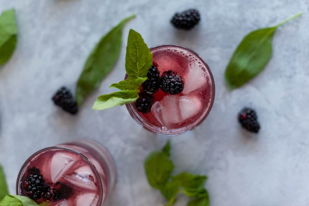 This blackberry basil mocktail may be lacking alcohol but it does not lack flavor!  The combination of blackberry, basil and lime sparkling water make a tart and sweet drink great for any party or to have at home without the hangover.