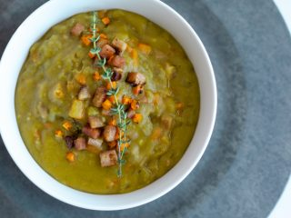 This split pea soup is a full hearty meal with lots of flavor coming from veggies and a smoky twist using ham. Perfect for cold nights or to batch cook for budget friendly meal prep. #soup #instantpot