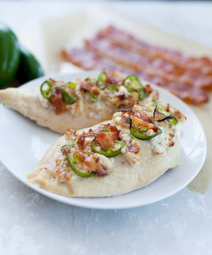 Jalapeno popper stuffed chicken breast on a white plate