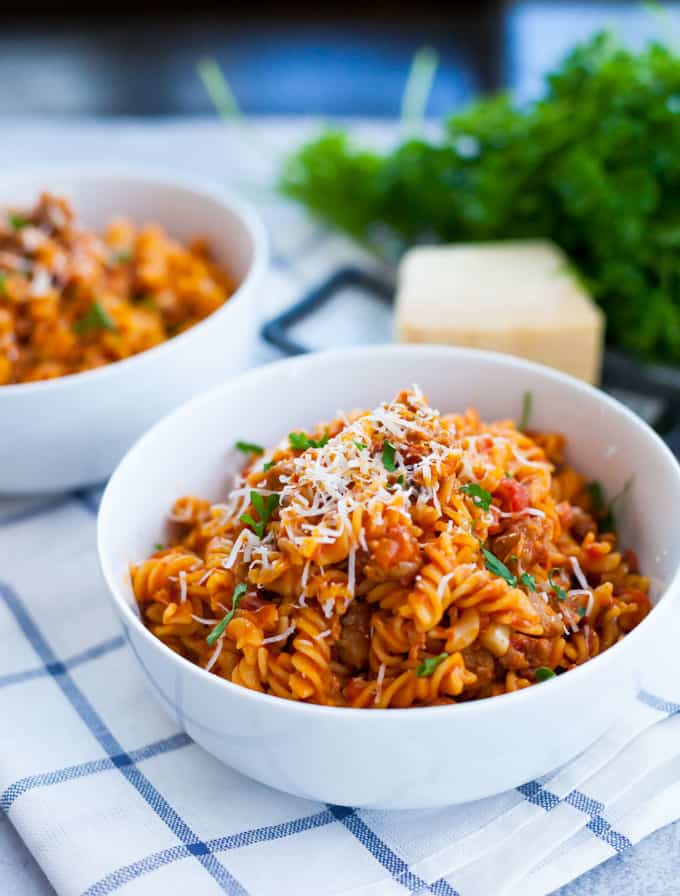 pasta and meat sauce in a white bowl