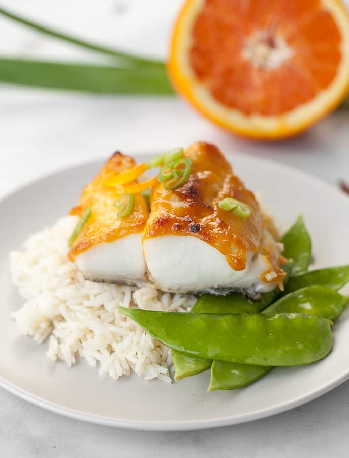 butterfish on top of rice with snap peas
